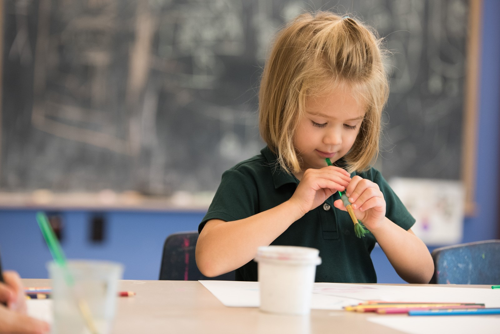 Young girl in art therapy at The Parish School