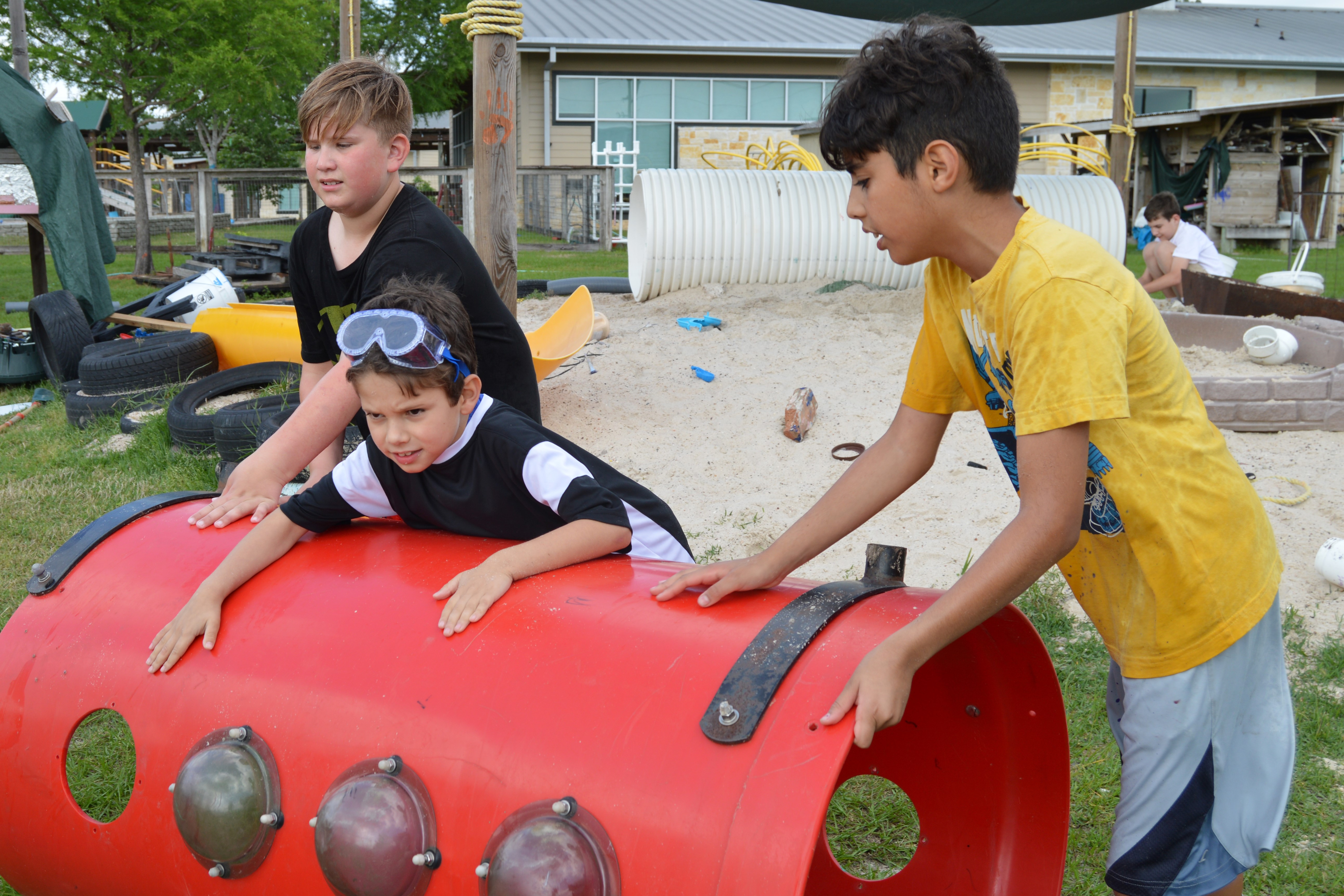 Adventure Play at Camp Acorn - boys rolling tube