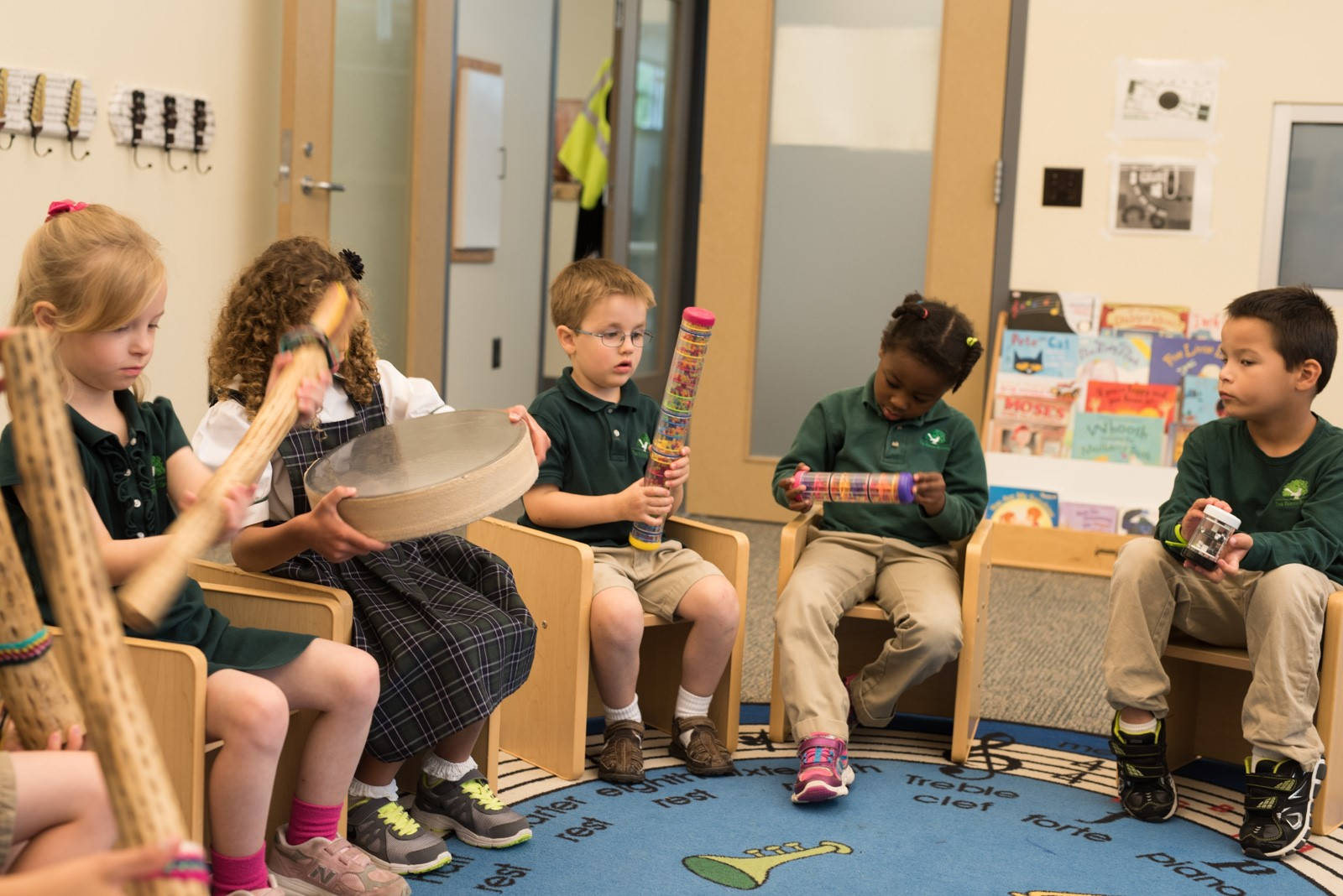 The Parish School music therapist works with a class of young children