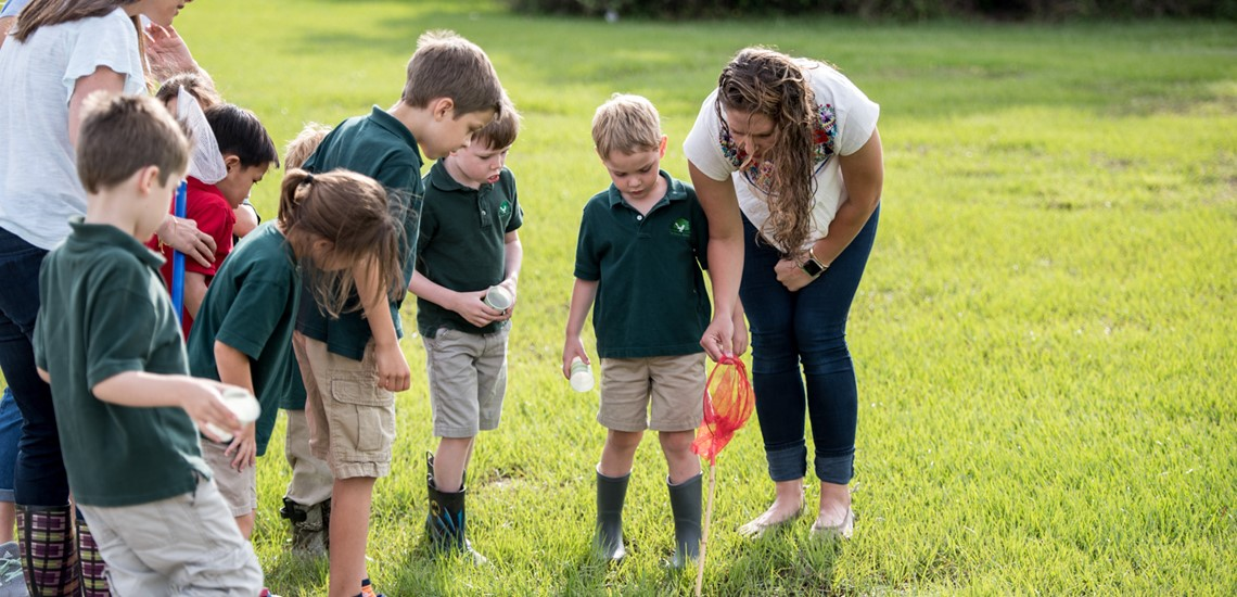 Students examine plants and creatures in nature studies class at The Parish School