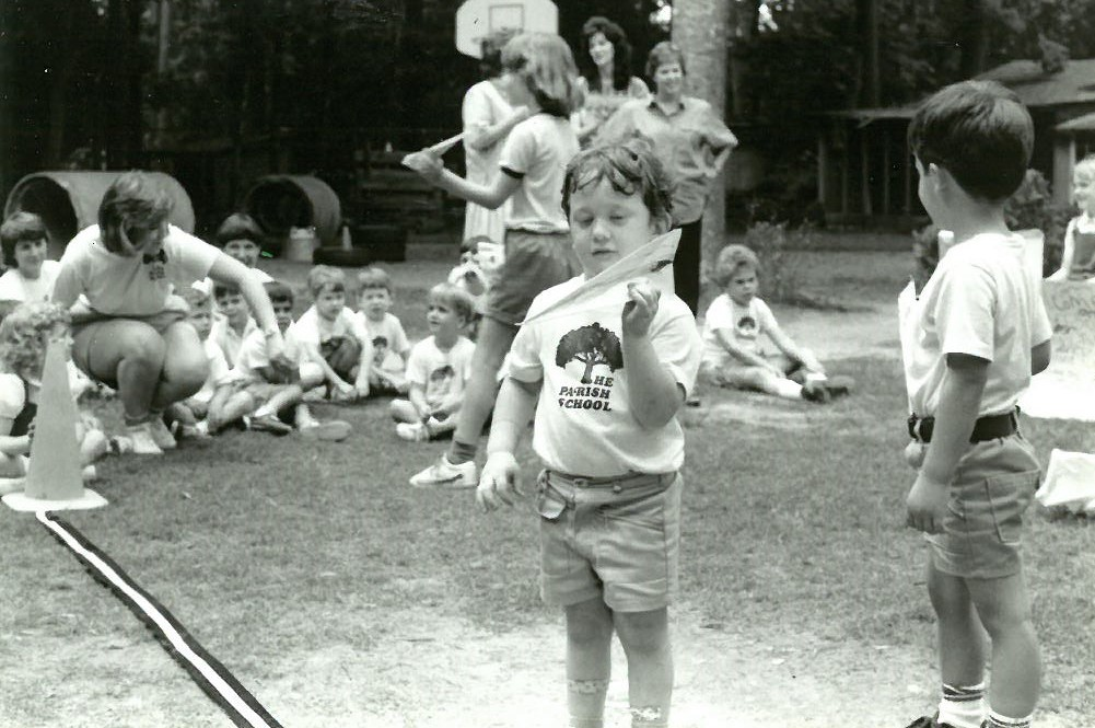 The Parish School 1983 Boy with paper airplane