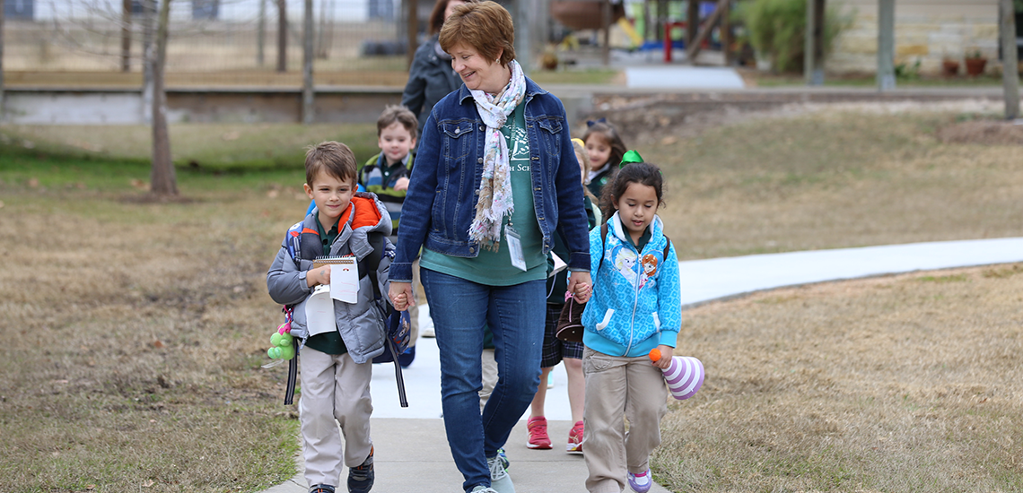 Parish School teacher/speech-language pathologist walks class to carpool