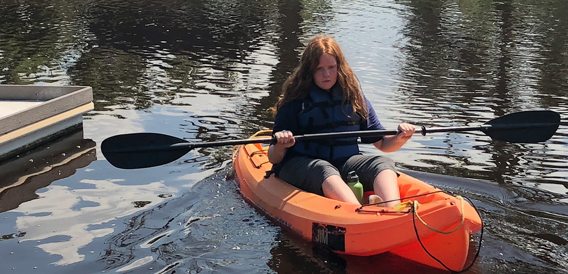 Camp Connect Girl Kayaking