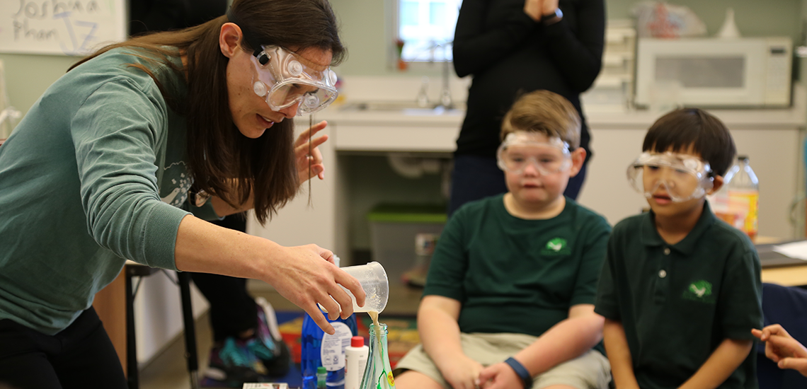 Elementary teacher/speech-language pathologist conducts science experiment for class at The Parish School