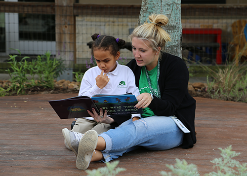teacher reading with child